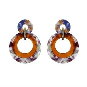 Lele Sadoughi banded hoop earrings.